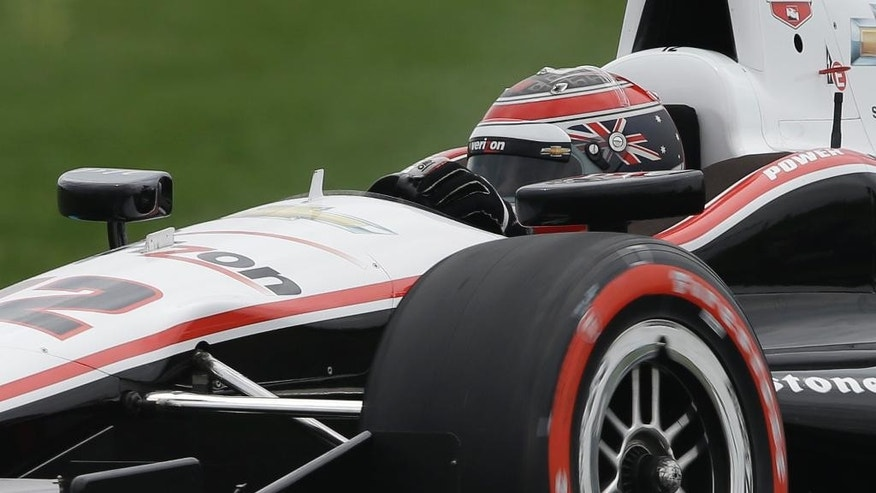Will Power, of Australia, drives through a turn during qualifications for the inaugural Grand Prix of Indianapolis IndyCar auto race at the Indianapolis Motor Speedway in Indianapolis, Friday, May 9, 2014. (AP Photo/Darron Cummings)