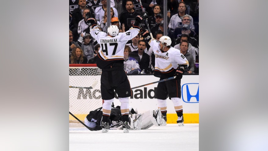 Anaheim Ducks right wing Teemu Selanne, right, of Finland, celebrates his goal along with defenseman Hampus Lindholm, left, of Sweden, as Los Angeles Kings goalie Jonathan Quick lays on the ice during the second period in Game 3 of an NHL hockey second-round Stanley Cup playoff series, Thursday, May 8, 2014, in Los Angeles. (AP Photo/Mark J. Terrill)