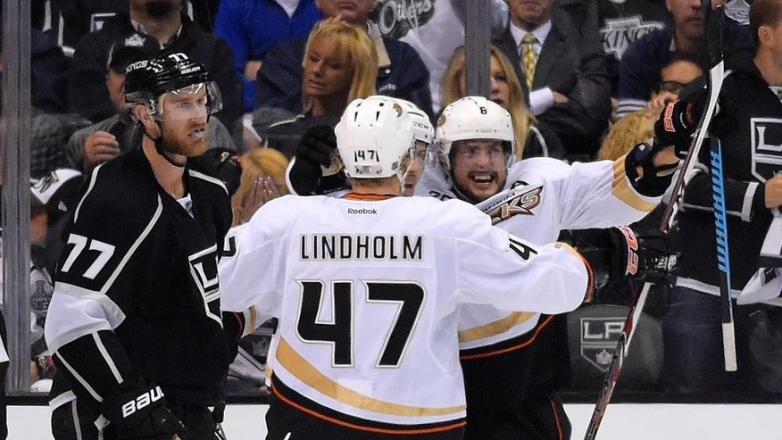 Anaheim Ducks right wing Teemu Selanne, right, of Finland, celebrates his goal along with defenseman Hampus Lindholm, center, of Sweden, as Los Angeles Kings center Jeff Carter looks on during the second period in Game 3 of an NHL hockey second-round Stanley Cup playoff series, Thursday, May 8, 2014, in Los Angeles. (AP Photo/Mark J. Terrill)