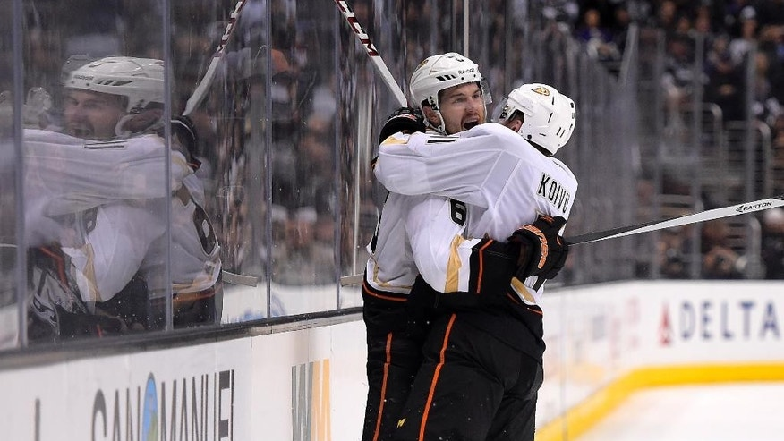 Anaheim Ducks defenseman Ben Lovejoy, left, celebrates his goal with center Saku Koivu, of Finland, during the third period in Game 3 of an NHL hockey second-round Stanley Cup playoff series against the Los Angeles Kings, Thursday, May 8, 2014, in Los Angeles. The Ducks won 3-2. (AP Photo/Mark J. Terrill)