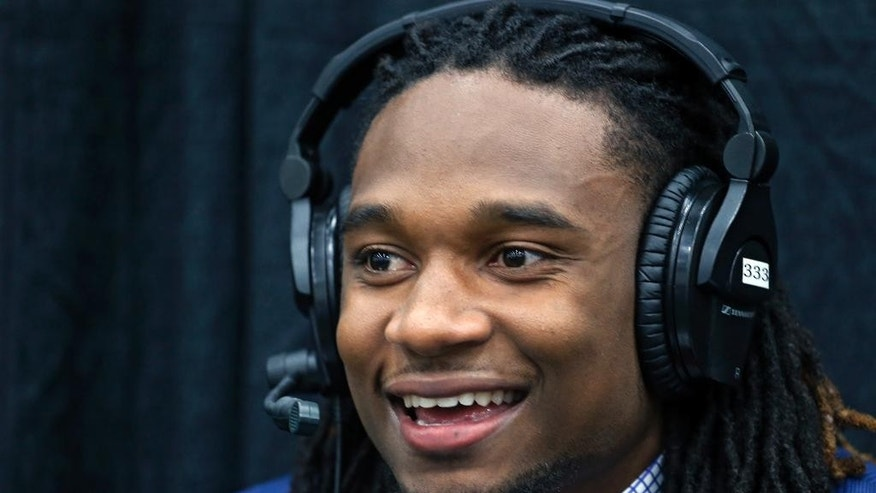 Denver Broncos first-round draft pick Ohio State cornerback Bradley Roby does a radio interview at the NFL football team's headquarters in Englewood, Colo., Friday, May 9, 2014. (AP Photo/Ed Andrieski)