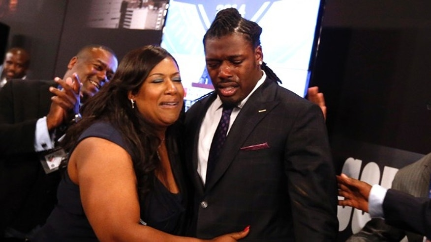 May 8, 20-14: Jadeveon Clowney, from South Carolina, reacts with his mother Josenna Clowney after being selected first overall by the Houston Texans in the first round of the NFL football draft at Radio City Music Hall in New York. (AP/Jason DeCrow)