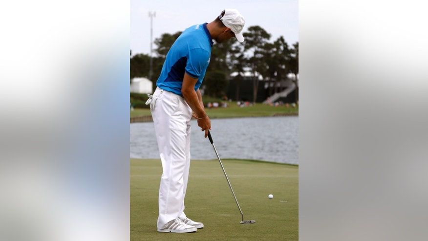 Martin Kaymer, of Germany, misses the 18th hole for bogey during the third round of The Players championship golf tournament at TPC Sawgrass, Saturday, May 10, 2014, in Ponte Vedra Beach, Fla. (AP Photo/Lynne Sladky)