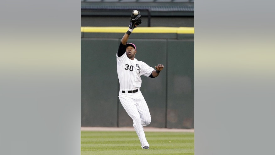 Chicago White Sox center fielder Alejandro De Aza catches a sacrifice fly ball hit by Arizona Diamondbacks' Martin Prado during the fifth inning of an interleague baseball game in Chicago, Saturday, May 10, 2014. (AP Photo/Nam Y. Huh)