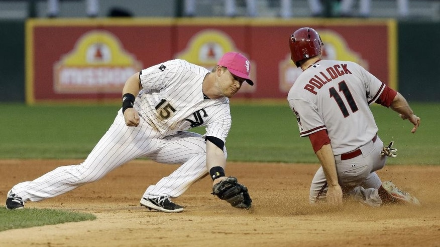 Arizona Diamondbacks' A.J. Pollock, right, steals second base as Chicago White Sox second baseman Gordon Beckham applies a late tag during the fifth inning of an interleague baseball game in Chicago, Saturday, May 10, 2014. (AP Photo/Nam Y. Huh)