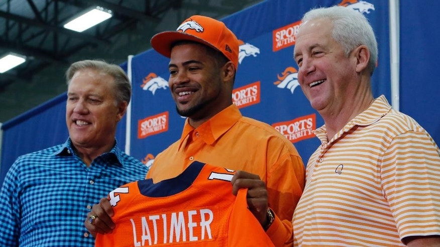Denver Broncos vice president John Elway,left,  head coach John Fox, right, flank the Broncos second round draft pick Indiana wide receiver Cody Latimer as he is introduced to the media at the NFL football teams headquarters in Englewood, Colo., on Saturday, May 10, 2014. (AP Photo/Ed Andrieski)