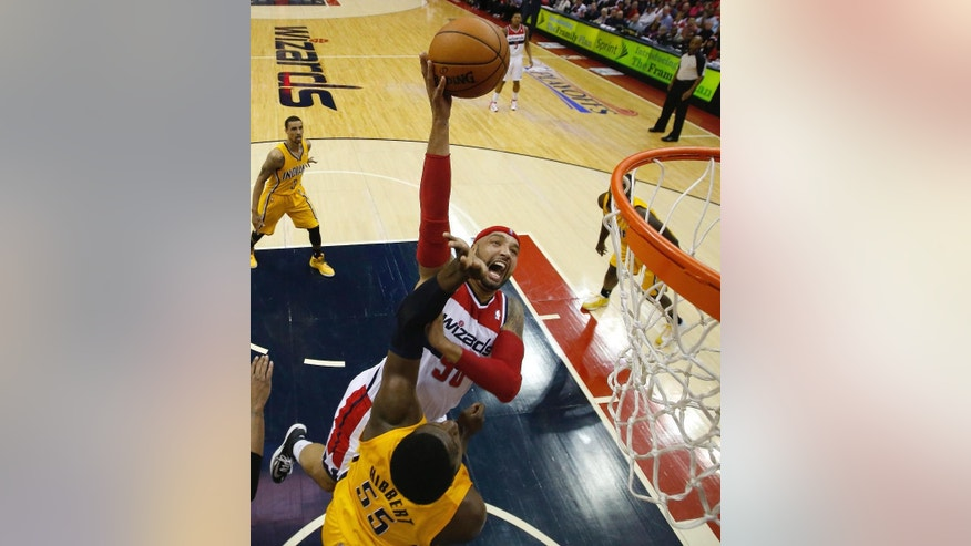 Washington Wizards forward Drew Gooden (90) shoots over Indiana Pacers center Roy Hibbert (55) during the first half of Game 4 of an Eastern Conference semifinal NBA basketball playoff game in Washington, Sunday, May 11, 2014. (AP Photo/Alex Brandon)