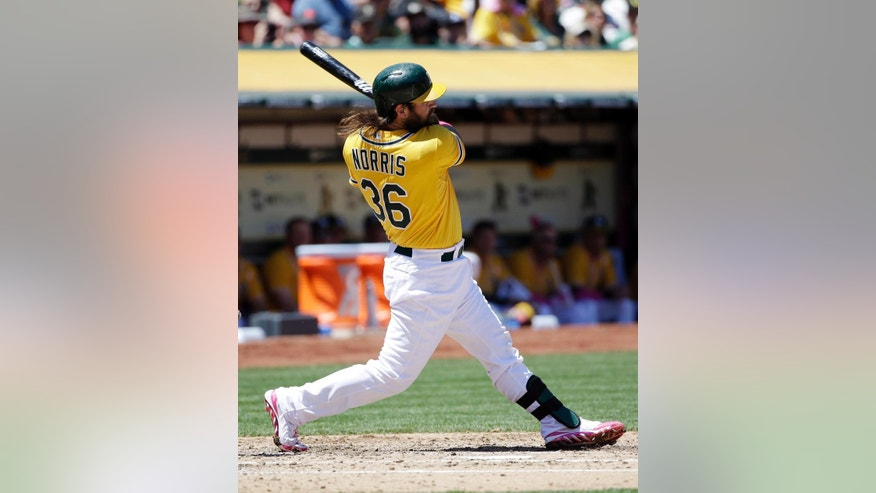 Oakland Athletics' Derek Norris hits his second three-run home run of a baseball game against Washington Nationals' Gio Gonzalez during the second inning on Sunday, May 11, 2014, in Oakland, Calif. (AP Photo/Marcio Jose Sanchez)