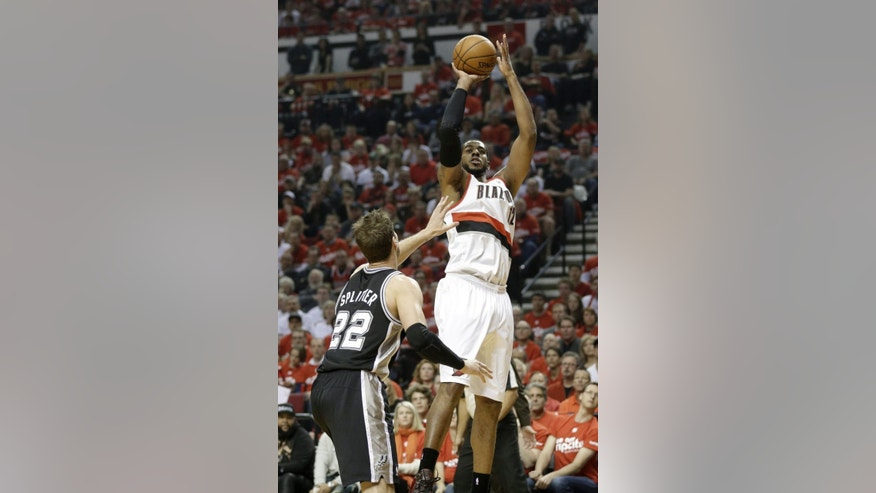 Portland Trail Blazers' LaMarcus Aldridge (12) shoots as San Antonio Spurs' Tiago Splitter (22) looks on in the first quarter during Game 3 of a Western Conference semifinal NBA basketball playoff series Saturday, May 10, 2014, in Portland, Ore. (AP Photo/Rick Bowmer)
