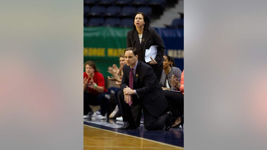 This March 6 2014 photo provided by the University of Richmond shows women's basketball associate head coach Ginny Doyle, top, and head coach Michael Shafer during a game against VCU, in Richmond, Va. Doyle and director of basketball operations Natalie Lewis were two of the three people aboard a hot air balloon that drifted into a power line, burst into flames and crashed on Friday, May 9, 2014, in Virginia. Investigators say their remains were found about a mile apart in dense woods. (AP Photo/University of Richmond, Mitchell Leff)