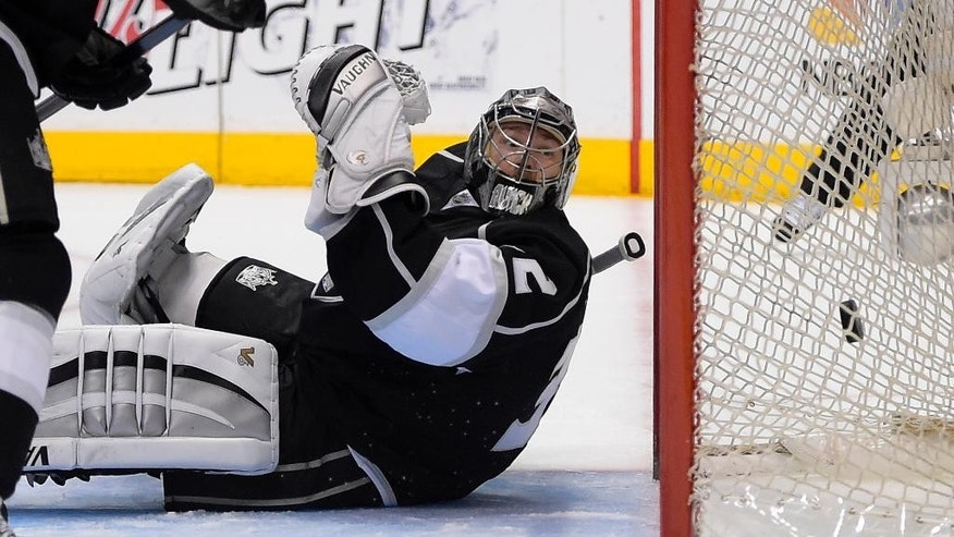 Los Angeles Kings goalie Jonathan Quick is scored on by Anaheim Ducks right wing Devante Smith-Pelly during the first period in Game 4 of an NHL hockey second-round Stanley Cup playoff series, Saturday, May 10, 2014, in Los Angeles. (AP Photo/Mark J. Terrill)