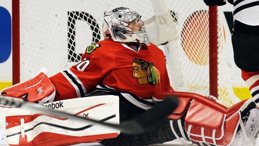 Chicago Blackhawks goalie Corey Crawford (50) reacts after Minnesota Wild's Erik Haula (56) scored his goal during the first period  in Game 5 of an NHL hockey second-round playoff series in Chicago,Sunday, May 11, 2014. (AP Photo/Nam Y. Huh)