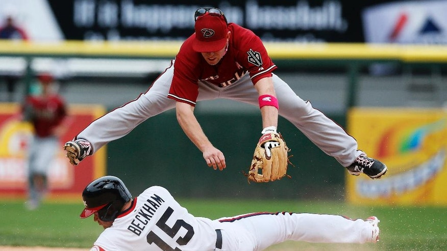 Arizona Diamondbacks second baseman Aaron Hill, top, forces out Chicago White Sox's Gordon Beckham on a double play to end the ninth inning of a baseball game on Sunday, May 11, 2014, in Chicago. The Diamondbacks won 5-1. (AP Photo/Andrew A. Nelles)