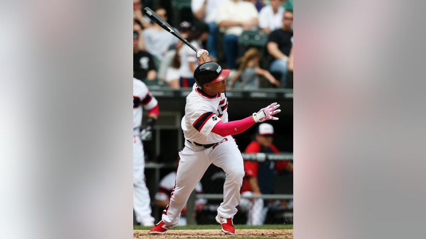 Chicago White Sox's Moises Sierra hits a solo home run during the sixth inning of a baseball game against the Arizona Diamondbacks, Sunday, May 11, 2014, in Chicago. (AP Photo/Andrew A. Nelles)