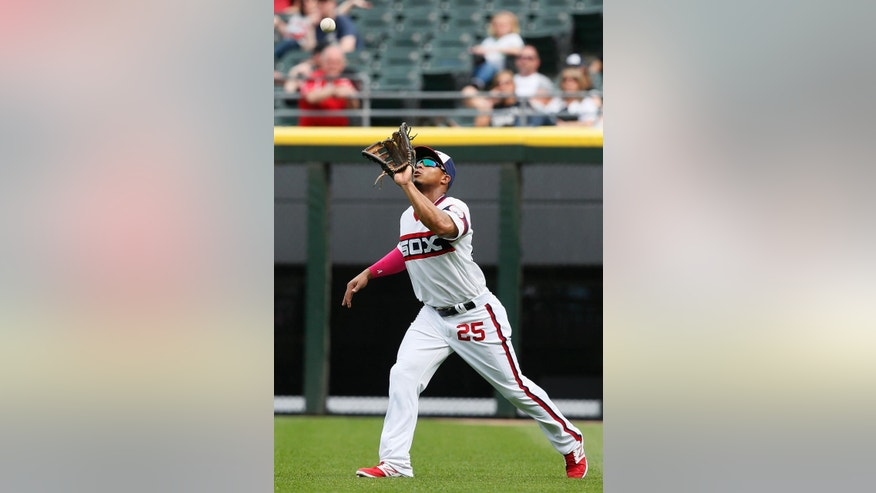Chicago White Sox right fielder Moises Sierra catches a fly ball hit by Arizona Diamondbacks' Martin Prado during the ninth inning of a baseball game on Sunday, May 11, 2014, in Chicago. (AP Photo/Andrew A. Nelles)