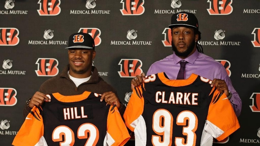 Cincinnati Bengals second round draft pick Jeremy Hill (32), a running back from LSU, and Will Clarke (93), a defensive end from West Virginia, are introduced during a news conference, Saturday, May 10, 2014, at the NFL football team's stadium in Cincinnati.  (AP Photo/Al Behrman)