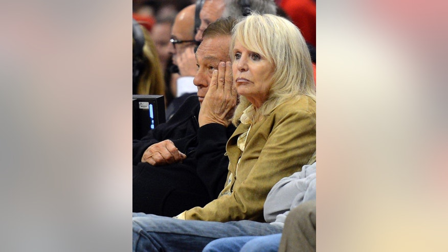 FILE - In this May 19, 2012, file photo, Los Angeles Clippers owner Donald Sterling, left, and his wife Rochelle watch during the second half in Game 3 of an NBA basketball playoffs Western Conference semifinal against the San Antonio Spurs in Los Angeles. An attorney representing the estranged wife of Clippers owner Donald Sterling said Thursday, May 8, 2014, that she will fight to retain her 50 percent ownership stake in the team. (AP Photo/Mark J. Terrill)