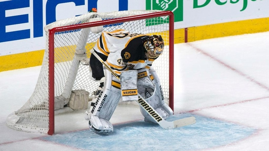 Boston Bruins goalie Tuukka Rask reacts following a goal by Montreal Canadiens' Thomas Vanek during the second period of an NHL playoff hockey game on Monday, May 12, 2014, in Montreal. (AP Photo/The Canadian Press, Paul Chiasson)