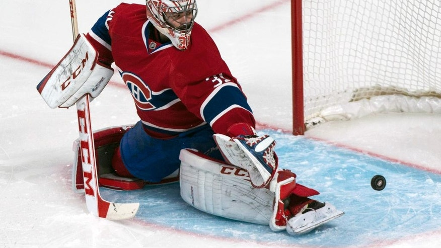 Montreal Canadiens goalie Carey Price stops a shot as they face the Boston Bruins during the second period of an NHL playoff hockey game on Monday, May 12, 2014, in Montreal. (AP Photo/The Canadian Press, Paul Chiasson)