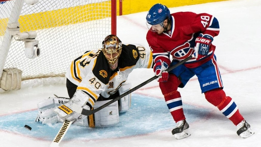 Boston Bruins goalie Tuukka Rask, left, stops Montreal Canadiens' Daniel Briere (48) during the second period of an NHL playoff hockey game on Monday, May 12, 2014, in Montreal. (AP Photo/The Canadian Press, Paul Chiasson)