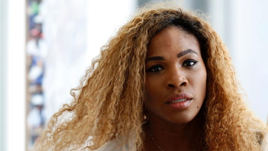 Serena Williams, of the United States, arrives for a press conference ahead of her participation at the Italian Open tennis tournament, in Rome, Monday, May 12, 2014. (AP Photo/Riccardo De Luca)