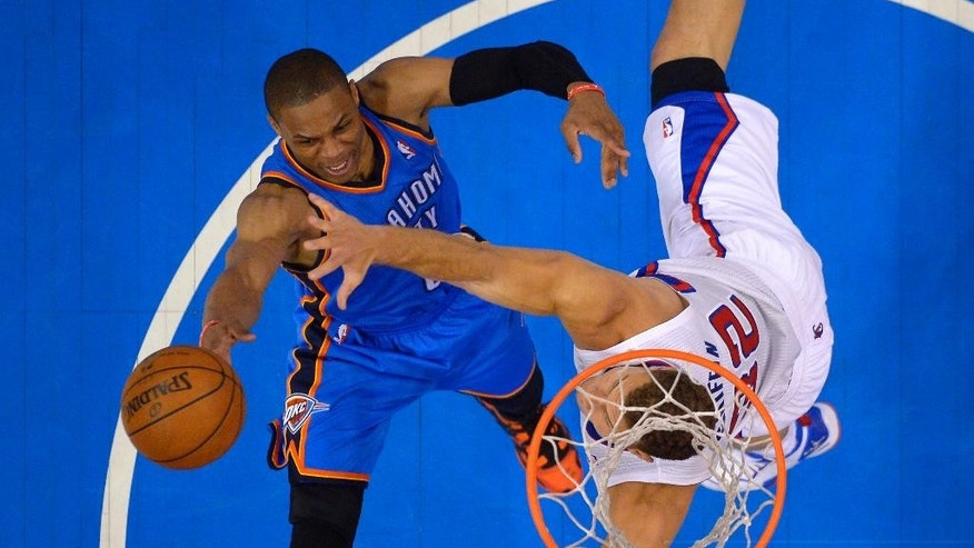 Oklahoma City Thunder guard Russell Westbrook, left, shoots as Los Angeles Clippers forward Blake Griffin defends in the second half of Game 4 of the Western Conference semifinal NBA basketball playoff series on Sunday, May 11, 2014, in Los Angeles. The Clippers won 101-99. (AP Photo/Mark J. Terrill)