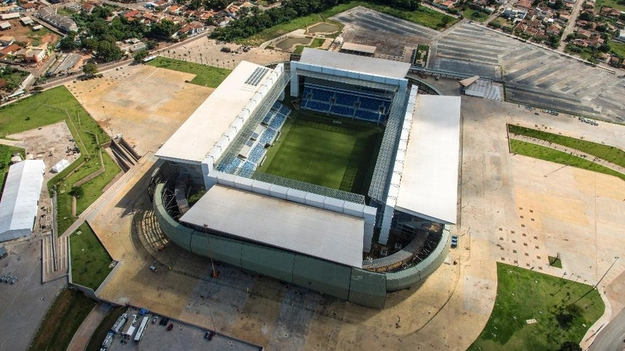This April 24 , 2014 photo released by Portal da Copa, shows an aerial view of the Arena Pantanal in Cuiaba, Brazil. Brazil had seven years to get ready for the World Cup, but it enters the final month of preparations with a lot yet to be done. There is also concern with the temporary structures at the Beira-Rio Stadium in southern Porto Alegre, and the other incomplete venue is the Arena Pantanal in the western city of Cuiaba, which is only expected to host an official test event at the end of the month. (AP Photo/Portal da Copa, Jose Medeiros)
