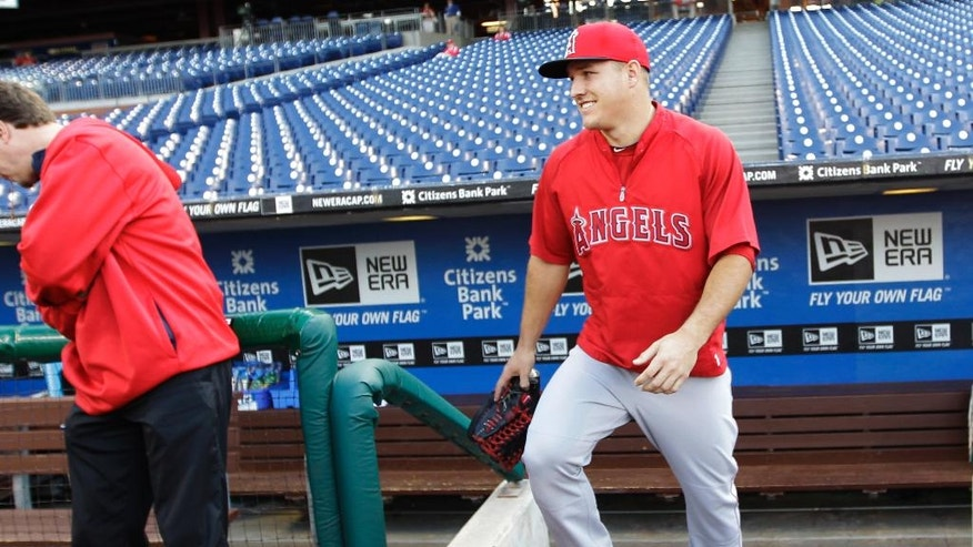 Los Angeles Angels' Mike Trout takes the field before the start of a baseball game with the Philadelphia Phillies, Tuesday, May 13, 2014, in Philadelphia. (AP Photo/Laurence Kesterson)