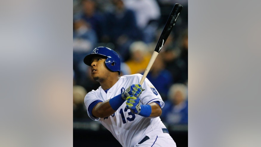 Kansas City Royals' Salvador Perez hits a solo home run off Colorado Rockies starting pitcher Franklin Morales during the fifth inning of a baseball game at Kauffman Stadium in Kansas City, Mo., Tuesday, May 13, 2014. (AP Photo/Orlin Wagner)