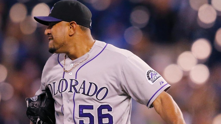 Colorado Rockies starting pitcher Franklin Morales throws down the rosin bag after giving up a two-run home run during the fourth inning of a baseball game against the Kansas City Royals at Kauffman Stadium in Kansas City, Mo., Tuesday, May 13, 2014. (AP Photo/Orlin Wagner)