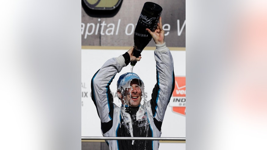 Simon Pagenaud, of France, pours sparkling wine over his head as he celebrates winning the inaugural Grand Prix of Indianapolis IndyCar auto race at the Indianapolis Motor Speedway in Indianapolis, Saturday, May 10, 2014. (AP Photo/Michael Conroy)
