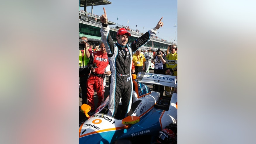 Simon Pagenaud, of France, celebrates as he climbs out of his car after winning the inaugural Grand Prix of Indianapolis IndyCar auto race at the Indianapolis Motor Speedway in Indianapolis, Saturday, May 10, 2014. (AP Photo/Michael Conroy)