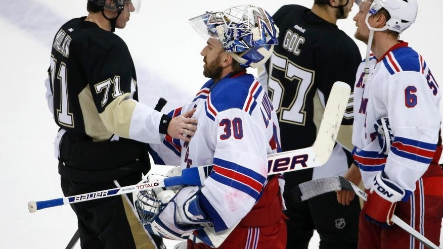 New York Rangers goalie Henrik Lundqvist (30) shakes hands with Pittsburgh Penguins' Evgeni Malkin (71) after the Rangers's 2-1 win in Game 7 of a second-round NHL playoff hockey series, in Pittsburgh on Tuesday, May 13, 2014. (AP Photo)