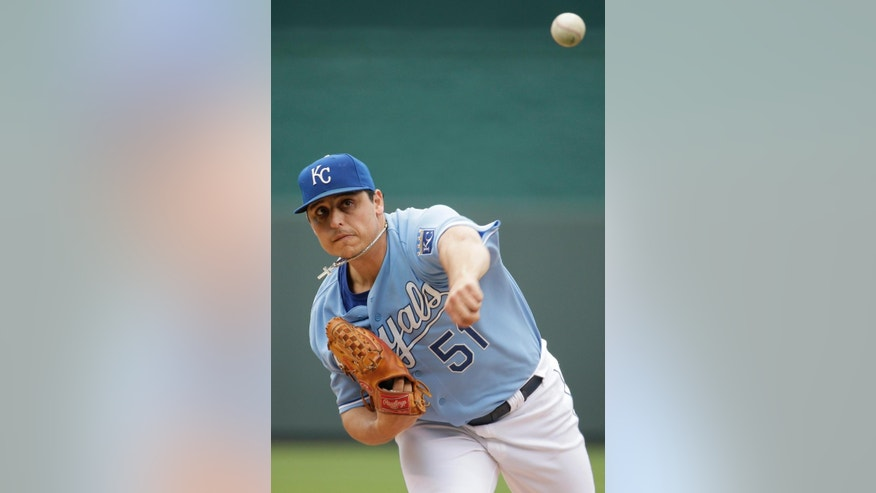Kansas City Royals starting pitcher Jason Vargas throws during the first inning of a baseball game against the Colorado Rockies Wednesday, May 14, 2014 in Kansas City, Mo. (AP Photo/Charlie Riedel)