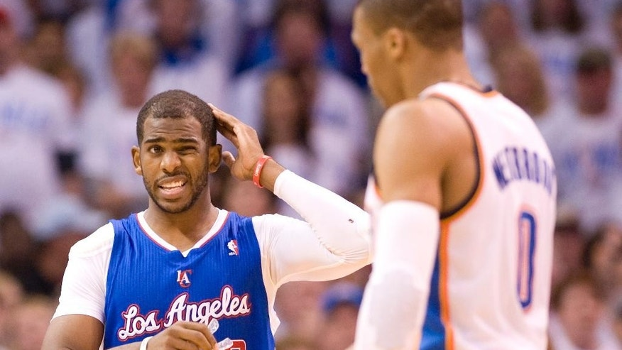 Los Angeles Clippers' guard Chris Paul rubs his head during a timeout after a foul was called on Oklahoma City Thunder's guard Russell Westbrook for bumping Pauls head during the first half in Game 5 of the NBA Western Conference semi-finals at the Chesapeake Arena in Oklahoma City on Tuesday, May 13, 2014.  (AP Photo/The Orange County Register, Michael Goulding) ///ADDITIONAL INFO.01.clippers.0514.mg- 05/13/2014  - MICHAEL GOULDING, ORANGE COUNTY REGISTER -  Clippers v Thunder Game 5 Western Conference semi-finals
