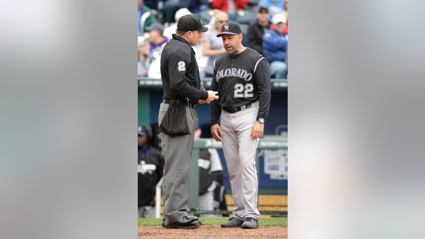 Colorado Rockies manager Walt Weiss questions a call with home plate umpire Dan Bellino during the fourth inning of a baseball game against the Kansas City Royals Wednesday, May 14, 2014 in Kansas City, Mo. (AP Photo/Charlie Riedel)
