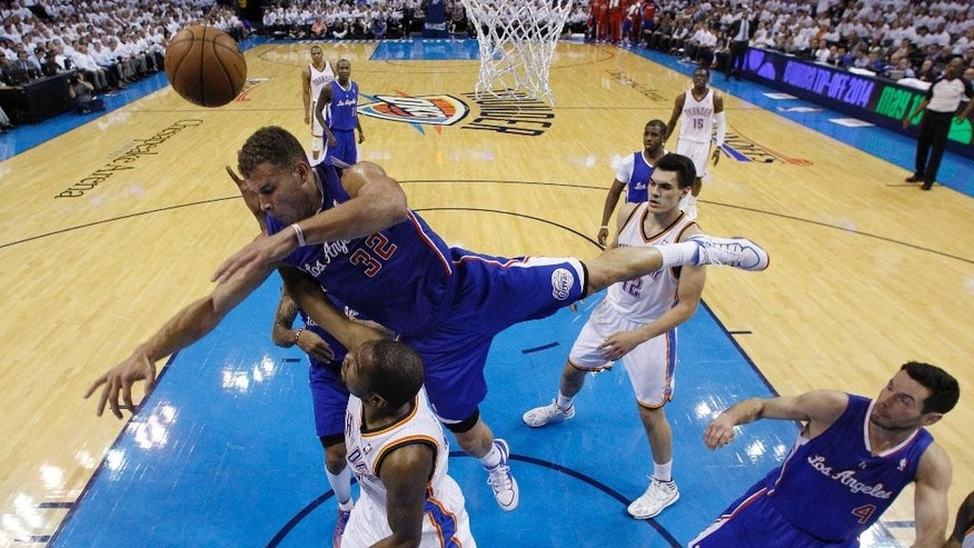 Oklahoma City Thunder forward Kevin Durant is fouled by Los Angeles Clippers forward Blake Griffin (32) in the second quarter of Game 5 of the Western Conference semifinal NBA basketball playoff series, in Oklahoma City on Tuesday, May 13, 2014. (AP Photo)
