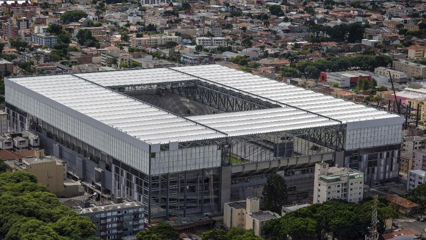 This March 20, 2014 photo released by Portal da Copa, shows an aerial view of the Arena da Baixada in Curitiba, Brazil. It's all coming down to the final 30 days. Brazil had seven years to get ready for the World Cup, but it enters the final month of preparations with a lot yet to be done. The unfinished stadium in Brazil's southern city of Curitiba, was nearly excluded from the tournament by FIFA earlier this year. The first full test at the venue is scheduled for this week.(AP Photo/Portal da Copa, Alexandre Carnieri)