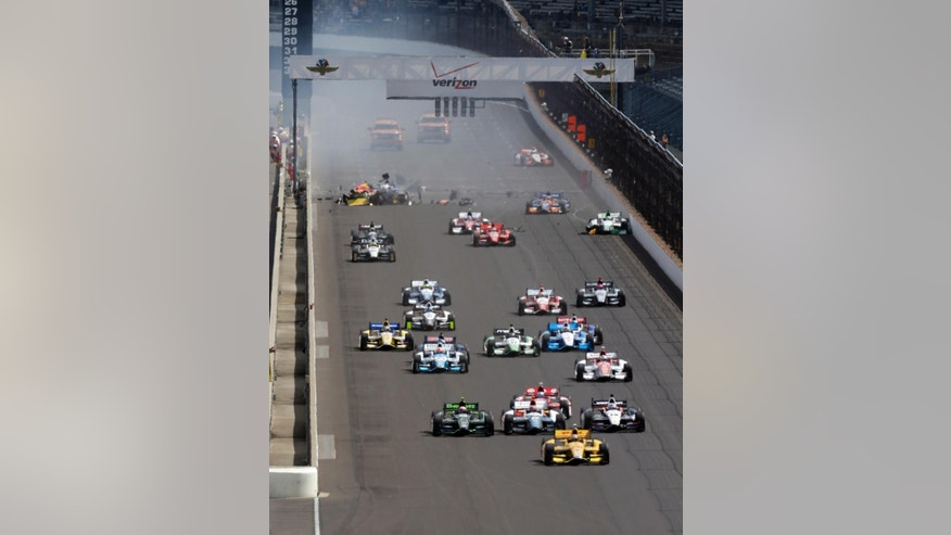 Ryan Hunter-Reay leads a the field at start of the inaugural Grand Prix of Indianapolis IndyCar auto race at the Indianapolis Motor Speedway in Indianapolis, Saturday, May 10, 2014. Sebastian Saavedra, of Colombia, Mikhail Aleshin, of Russia, and Carlos Munoz, of Bogota, were all involved in an accident at the start of the race.(AP Photo/Darron Cummings)
