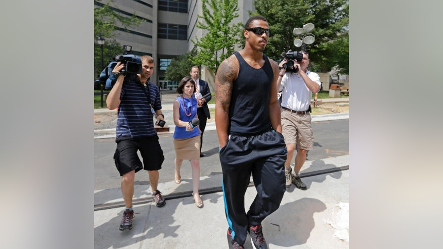 Carolina Panthers NFl football defensive end Greg Hardy leaves the Mecklenburg County jail after being released on bond in Charlotte, N.C., Wednesday, May 14, 2014. Hardy was arrested Tuesday and charged with assault on a female and communicating threats. (AP Photo)