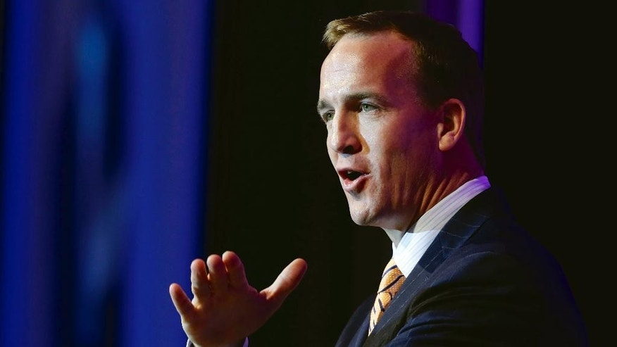 "Denver Broncos quarterback Peyton Manning speaks at the B'nai B'rith sports banquet in Omaha, Neb., Thursday, May 15, 2014. Manning's pre-snap shouts of ""Omaha"" put the Midwestern city in the national spotlight during the NFL playoffs and Super Bowl. (AP Photo/Nati Harnik)"