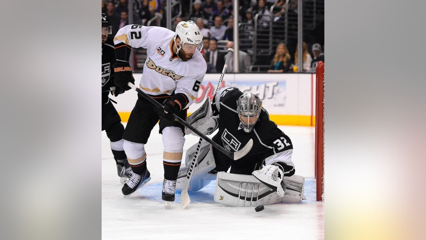 Anaheim Ducks left wing Patrick Maroon, left, tires get a shot in on Los Angeles Kings goalie Jonathan Quick during the first period in Game 6 of an NHL hockey second-round Stanley Cup playoff series, Wednesday, May 14, 2014, in Los Angeles. (AP Photo)