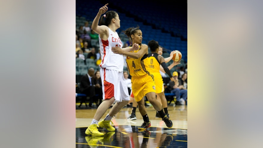 Tulsa Shock's Skylar Diggins (4) holds China's Yu Dong (13) during a WNBA basketball game on Monday, May 12, 2014, in Tulsa, Okla. (AP Photo/Tulsa World,  Joey Johnson)
