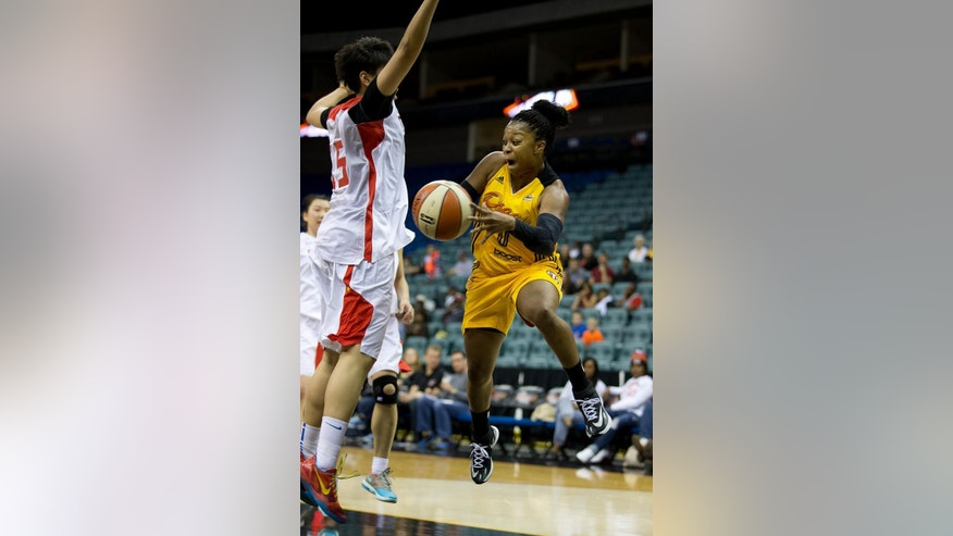 Shock's Odyssey Sims (0) passes around China's Yang Hengyu (15) during a WNBA basketball game on Monday, May 12, 2014. (AP Photo/Tulsa World,  Joey Johnson)