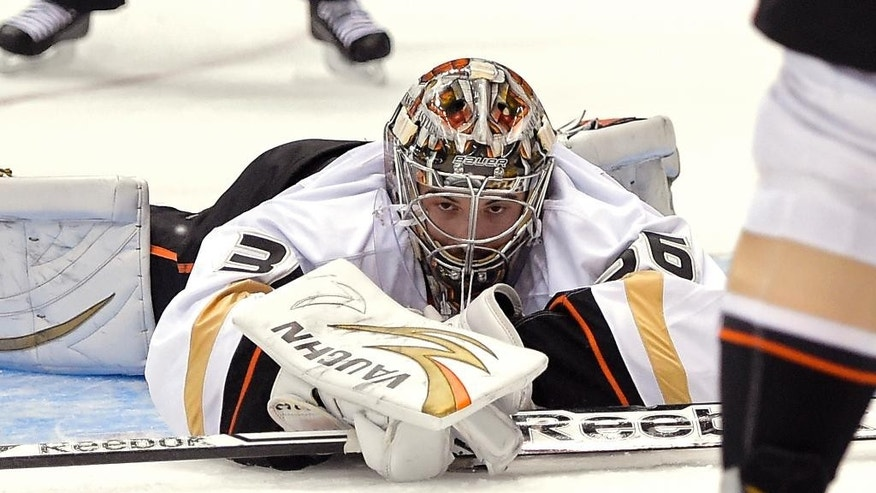 Anaheim Ducks goalie John Gibson covers the puck during the second period in Game 6 of an NHL hockey second-round Stanley Cup playoff series against the Los Angeles Kings, Wednesday, May 14, 2014, in Los Angeles. (AP Photo)