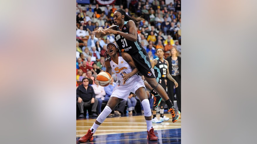 Connecticut Sun's Chiney Ogwumike, left, is fouled by New York Liberty's Tina Charles, right, during the first half of their WNBA basketball game in Uncasville, Conn., Friday, May 16, 2014. (AP Photo/Fred Beckham)