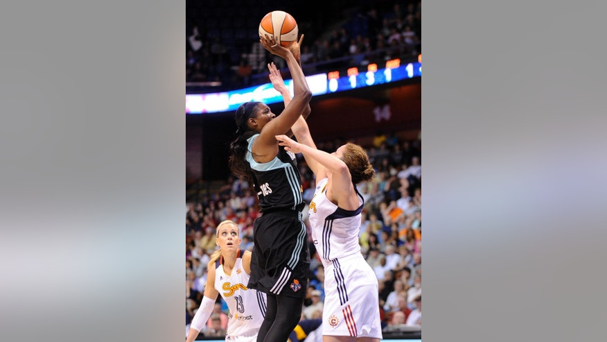 New York Liberty's Delisha Milton-Jones, left, shoots over Connecticut Sun's Kelsey Griffin, right,  during the first half of their WNBA basketball game in Uncasville, Conn., Friday, May 16, 2014. (AP Photo/Fred Beckham)