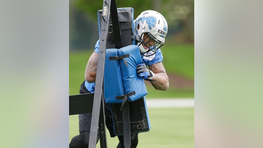 Detroit Lions tight end Eric Ebron hits a tackle sled during drills at the Lions rookie camp in Allen Park, Mich., Friday, May 16, 2014. It was a bit of a surprise when the Lions took a tight end in the first round of the draft, but Ebron could have a chance to excel in Detroit's passing game. (AP Photo/Carlos Osorio)