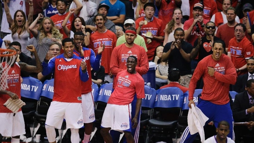 The Los Angeles Clippers bench celebrates a basket made by DeAndre Jordan during the first half in Game 6 of the NBA Western Conference semi-finals against the Oklahoma City Thunder on Thursday, May 15, 2014, in Los Angeles. (AP Photo/Jae C. Hong)