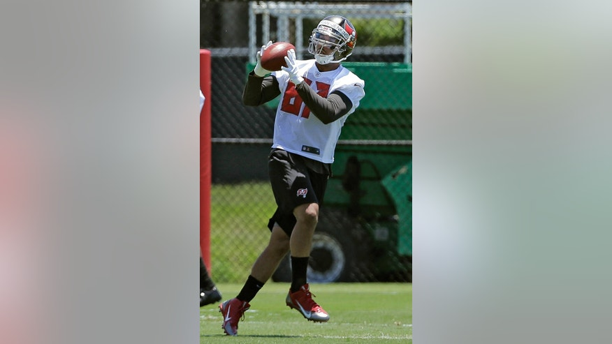 Tampa Bay Buccaneers second-round draft pick tight end Austin Seferian-Jenkins catches a pass during NFL football rookie camp Friday, May 16, 2014, in Tampa, Fla. (AP Photo/Chris O'Meara)